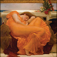 Woman in orange dress asleep on couch