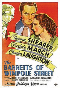 MGM poster of Norma Shearer, Frederic March and Charles Laughton