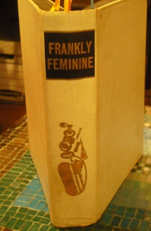 Cover of Frankly Feminine, spine facing
